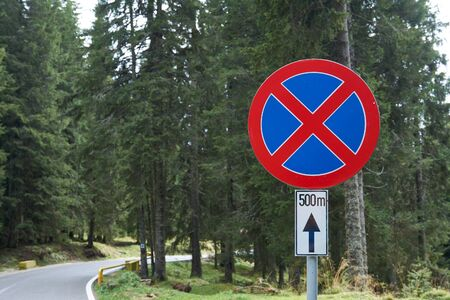 The road sign Stopping prohibited prohibits the stopping and parking of vehicles. Road rules, Traffic code. Reklamní fotografie