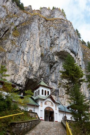 Ialomita Cave Monastery is located in Moreni commune, in the Bucegi Mountains, Romania. The monastery is located at the entrance to the Lalomita Cave. Religious building, Orthodox Christian temple.