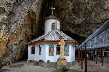 Ialomita Cave Monastery is located in Moreni commune, in the Bucegi Mountains, Romania. The monastery is located at the entrance to the Lalomita Cave. Religious building, Orthodox Christian temple.