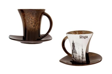 Ð¡eramic cup and saucer for coffee or tea. Souvenir dishes with the image of the city of Riga. Isolated, white background.