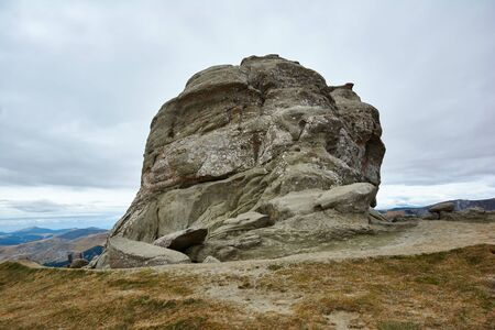 Peak Baba Mare, stone in the Bucegi Natural Park in Romania. Megaliths on top of a mountain range, tourist attraction.
