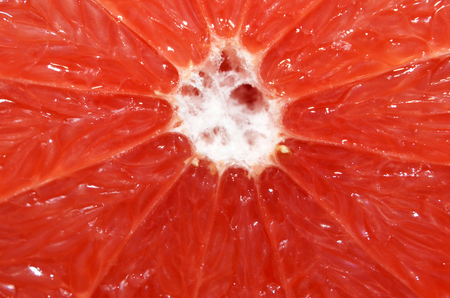 Fresh red grapefruit meat texture and pattern, a maro image of red pomelo meat texture