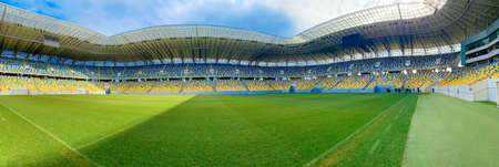 Lviv, Ukraine - March 1, 2020 : panoramic view of Arena Lviv Stadium, soccer field stadium and stadium seats on a non sporting day, mobile photo