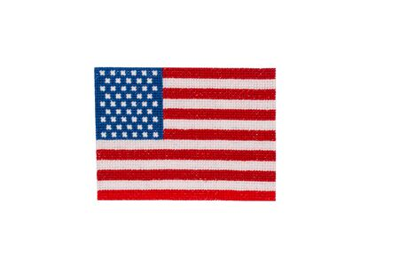 Cross stitch american flag isolated on white. National symbolic of USA - flag Old Glory. Flag Day and Independence Day celebration concept. Handmade pattern