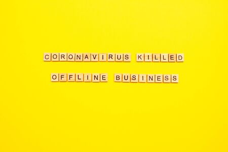 Coronavirus killed offline business - inscription written with black letters on wooden blocks on bright yellow background for your project, after coronavirus quarantine crisis concept