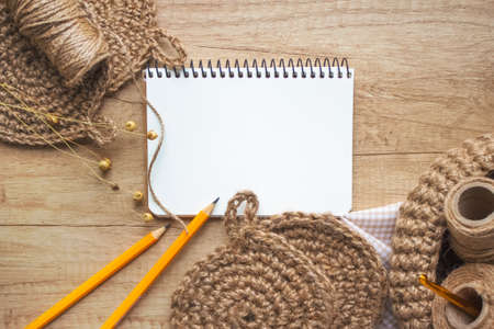 Creative composition with natural jute twine roll - linen or cannabis and jute washclothes on wooden background and empty paper for notes - copyspace for your text. Handmade DIY and hobby concept 版權商用圖片