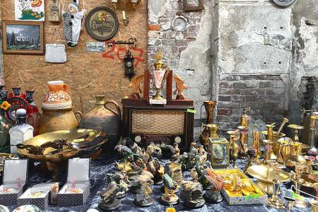 Lviv, Ukraine - May 16, 2021 : garage sale in Lem Station, Tlum and Kram. Hipster vintage goods on flea market. Thrift shopping, vintage radio gramophone player, collectible statues etc.