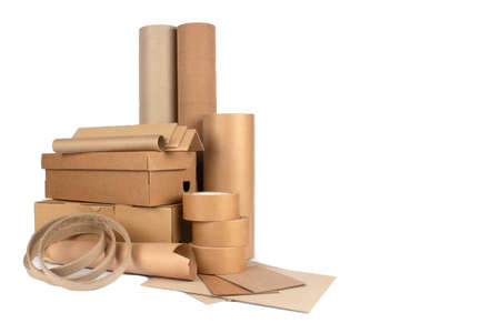 Set of different cardboard boxes, rolls of paper, paper edge protectors and tubes, sheets of paper and cardboard isolated for your presentation, catalogue or website. Sustainable packaging concept