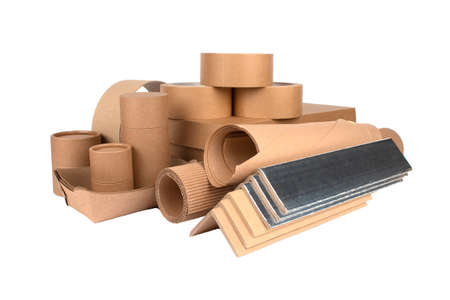 Paper packaging - cardboard edge protectors with alu paper, cardboard boxes, rolls of paper, paper tubes, packaging scotch tape, sheets of cardboard isolated. Sustainable packaging concept Standard-Bild