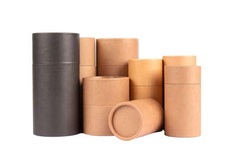 Different black and brown paper tubes with paper cap or lids, cardboard containers for packaging isolated on white background with copy space, mockup. Natural cosmetic paper packaging Standard-Bild