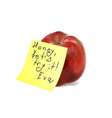 the tempter: Fresh red apple with Evas notes on yellow notepaper  Stock Photo