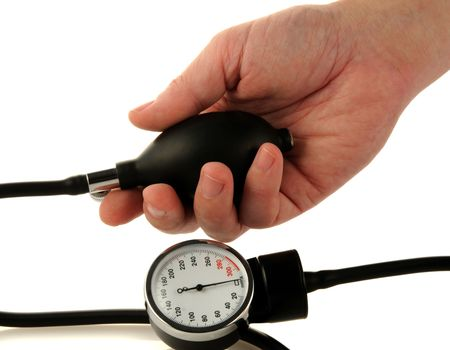 Male hand and medical tool for blood pressure measuring photo