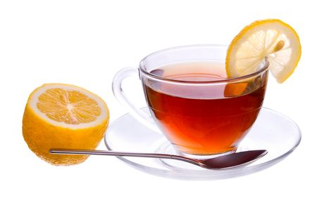 Transparent cup with black tea with a lemon and spoon isolated on white background photo