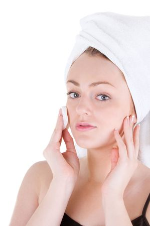 Young woman with white towel on hair is cleaning her face. Stock Photo - 6172261