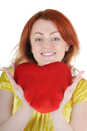 Young beautiul woman with red heart in her hands on white background. Focus on woman's eyes. Stock Photo - 6276414