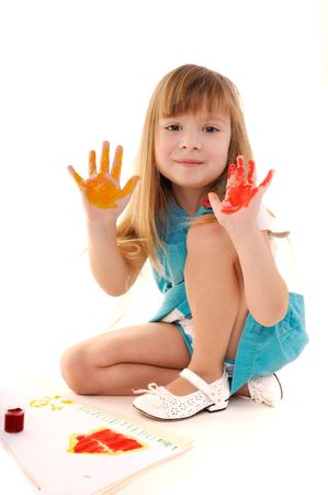 Small playful beauty girl with many-coloured hands and painted home on white background