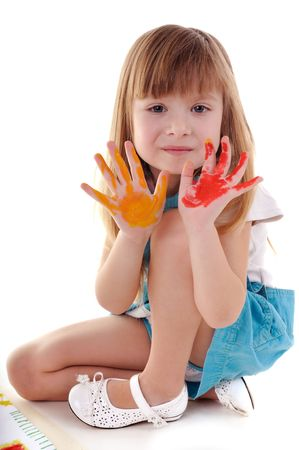 Small playful beauty girl with many-coloured hands on white background photo