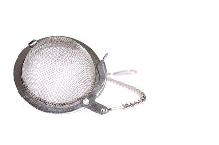 strainer: Metal tea strainer on white background close-up