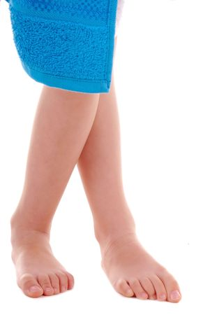big foot: Playful childs legs with blue towel on white background