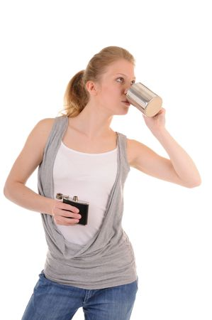 flack: Casual blonde girl with metal cup and flack is drinking