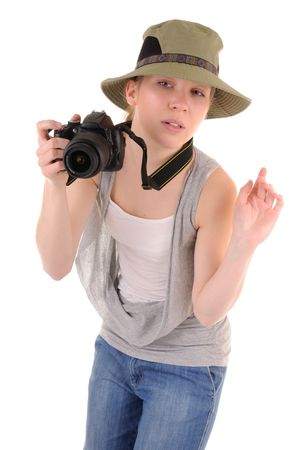 Casual girl-tourist with digital photocamera is looking for picture on white background Stock Photo - 6900764