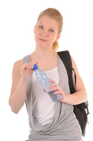 Nice girl in casual style with bottle with clear water isolated on white background photo