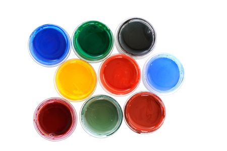 Many cans with different paints on white background photo
