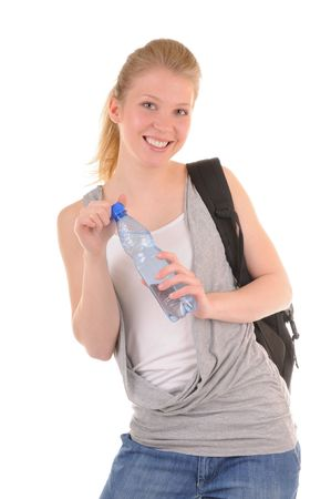 Nice smiling girl in casual style with bottle with clear water isolated on white background photo