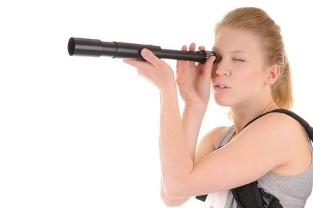 Attractive smiling young woman is looking through telescope on white background photo
