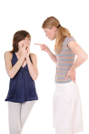 strife: One young woman is scolding another girl on white background