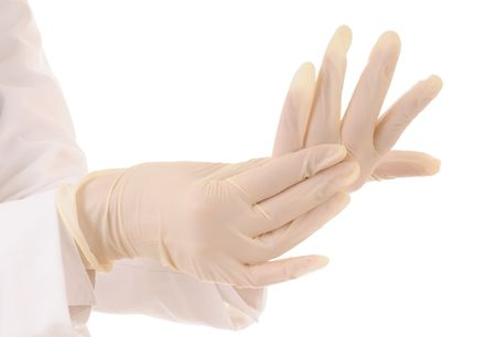 Two hands in medical gloves and white coat. Isolated on white background. Stock Photo