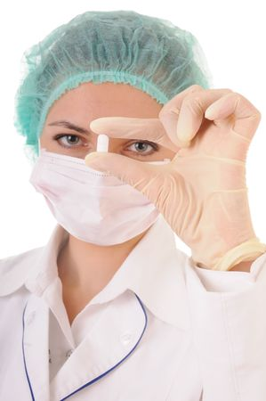 Woman in white coat, gloves, mask and cap with tablet in hands. Isolated on white background. Focus on the tablet. Stock Photo - 7318446