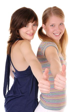 Two smilling girls are showing thumbs up on white background. Focus on hands.  photo