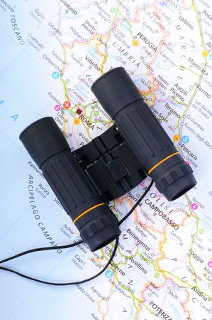 Concept of travel with map of Italy and binoculars photo