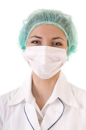 enfermera con cofia: M�dico sonriente en la m�scara y Gorra azul aislados sobre fondo blanco