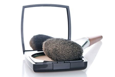 Make-up brush on powder-case with mirrow. Selective focus on front Stock Photo - 8224172