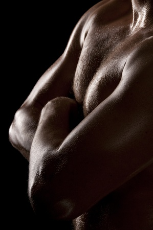 Athletic male torso in dark key. Focus on the chest. Stock Photo - 8557956