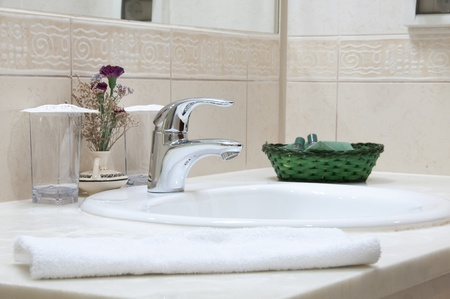 Hotel bathroom: sink, tap, towel and bathroom set Stock Photo - 8557951