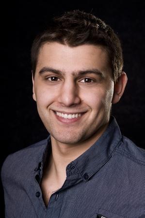 Casual caucasian man portrait on black background photo