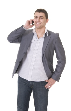 Yiung casual young man in jeans and jacket with phone isolated on white background Stock Photo - 8974375