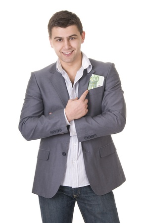 putting money in pocket: Young businessman putting is pointing on money in his pocket isolated on white background