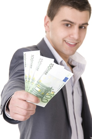1 euro: Young businessman offering money isolated ob white background. Focus on the money.