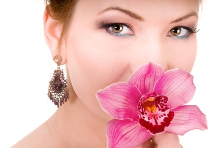 Pink Orchids and beauty woman on white background photo