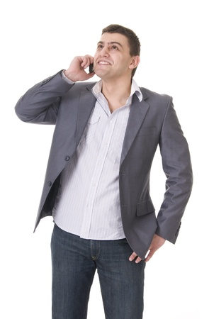 Young casual man in jeans and jacket with phone isolated on white background photo