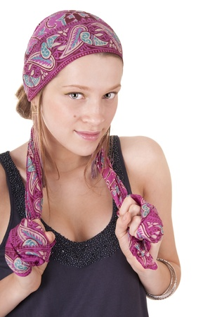 head and shoulders: Young woman in headscarf isolated on white background