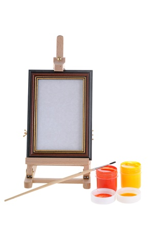 Easel, paints and bruch. isolated on white background. photo