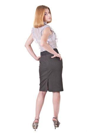 Full-lenght portrait young turning round woman in blouse and skirt on white Stock Photo - 10462216