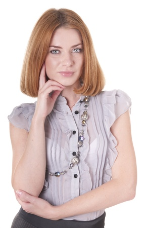 Strict young woman in blouse and skirt photo