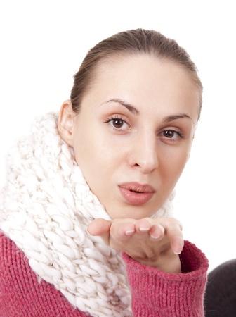 brune: Beautiful woman in winter scarf blow kisses Stock Photo
