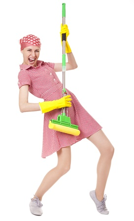 Playful charwoman with mop on white photo